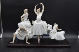 A Lladro figure group, classical ballerinas preparing for a performance, maker's impressed mark to