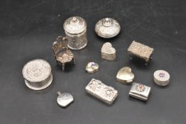 A miscellaneous collection of English and Continental silver and white metal lidded pill boxes,