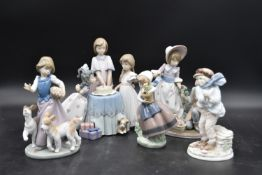A collection of five Lladro figure groups, children in various activities. H.23cm