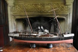 An early 20th century scratch built model of a steamer on stand. H.80 L.126cm