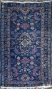 A Bidjar rug with central scrolling foliate medallion on a sapphire ground within floral borders.