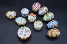 A collection of six gilt metal and porcelain hand decorated Limoges pill boxes along with five