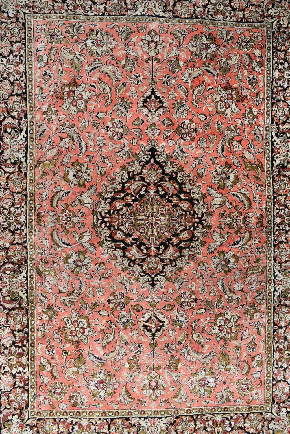 A pair of silk Persian rugs with central floral pole medallion on a madder ground with scrolling - Image 2 of 4