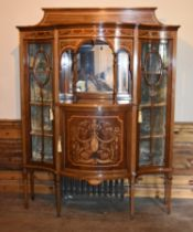 An Edwardian mahogany mirror backed display cabinet with a profuse swag and ribbon inlaid central