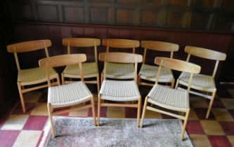 Hans Wegner for Carl Hansen & Son, a set of eight teak dining chairs model CH23 on restrung corded