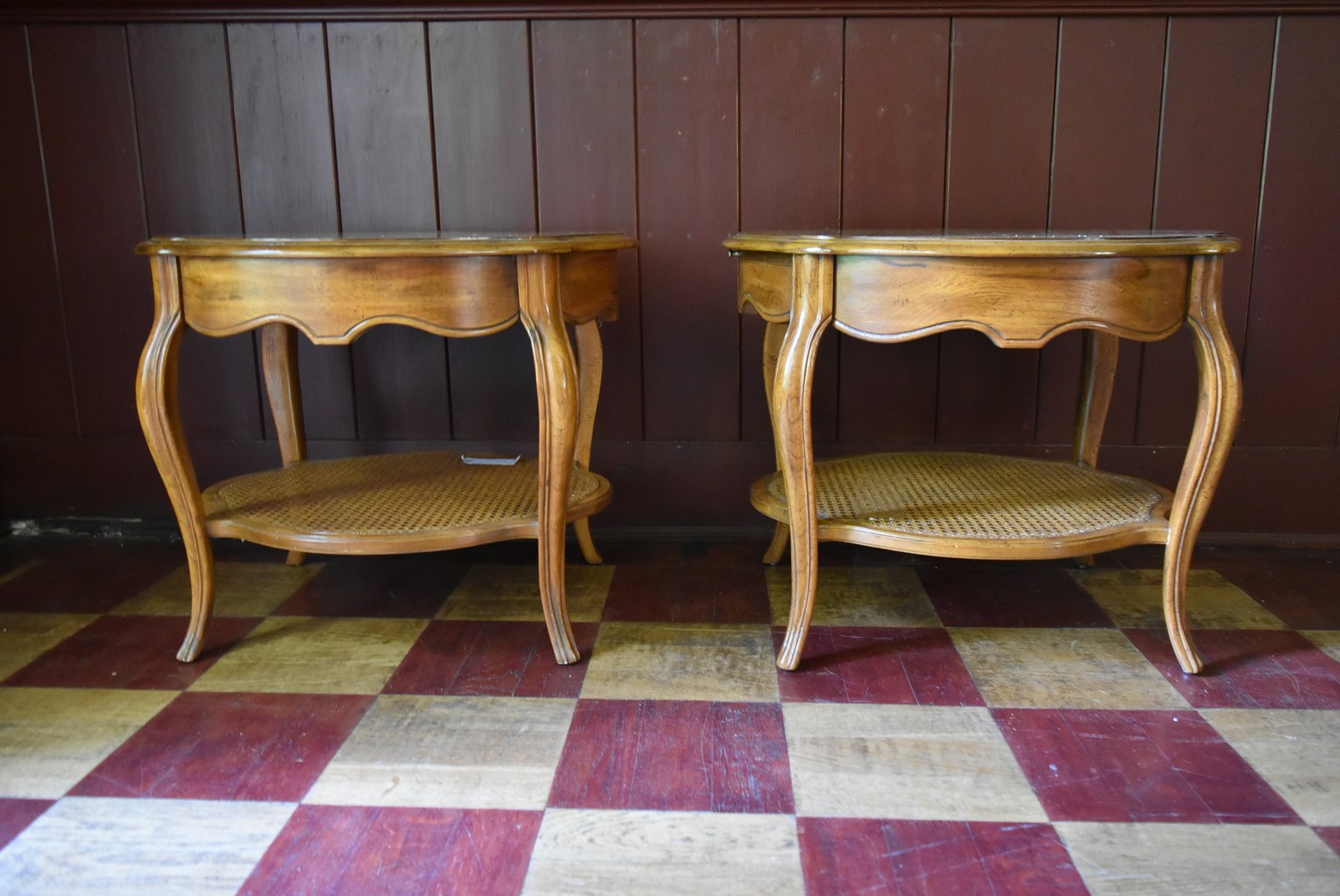 A pair of French style walnut quarter veneered and crossbanded side tables with plate glass tops