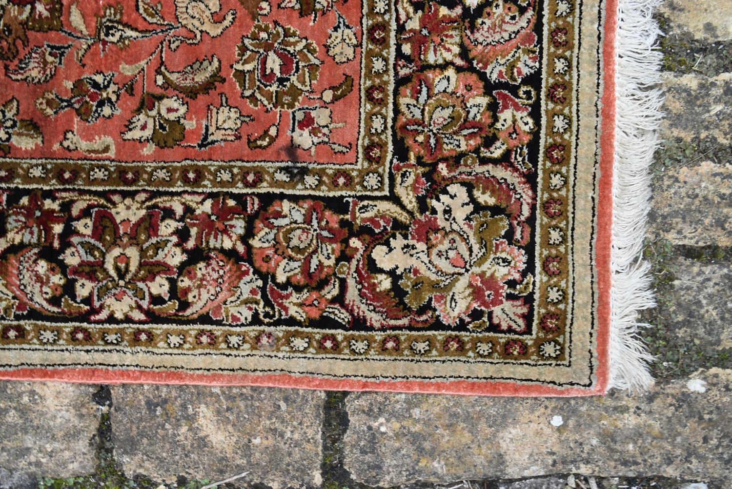 A pair of silk Persian rugs with central floral pole medallion on a madder ground with scrolling - Image 3 of 4