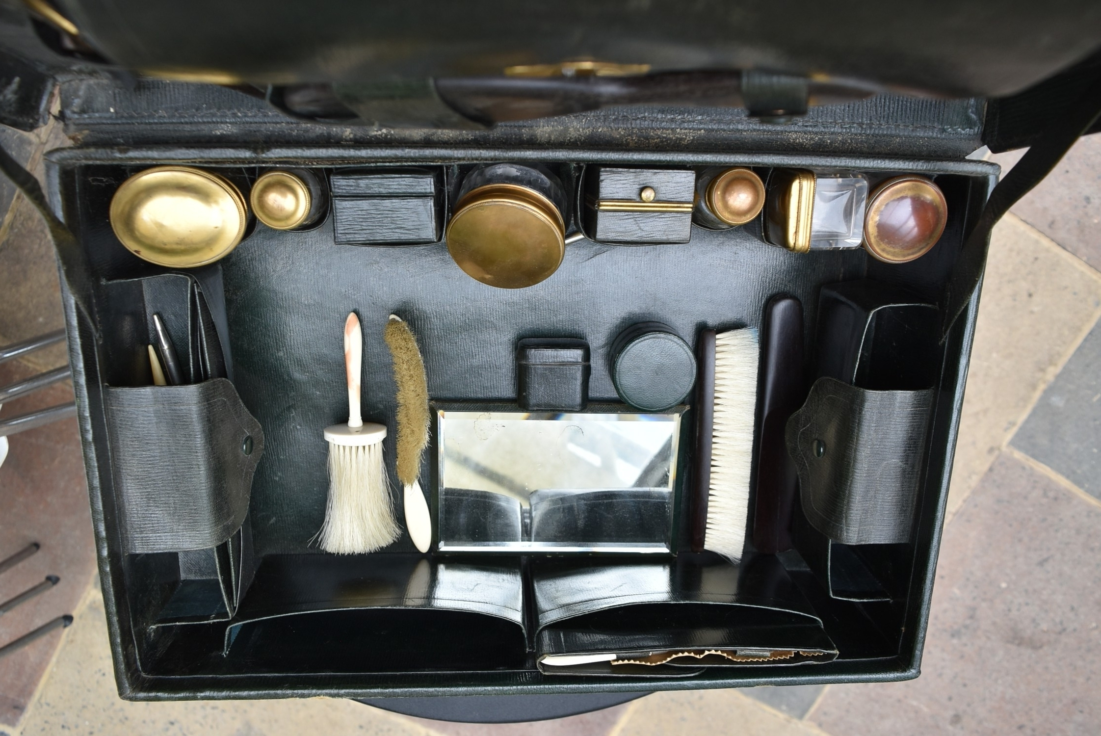 An early 20th century leather travelling gentleman's dressing case, well fitted with a wide - Image 7 of 10