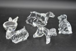 A collection of four Baccarat crystal dogs to include a Scottish terrier and hunting dogs, all