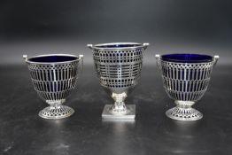 A pair of silver swing handled cream pails, EBs Ltd for Edward Barnard & Sons Ltd, Birmingham, 1928,