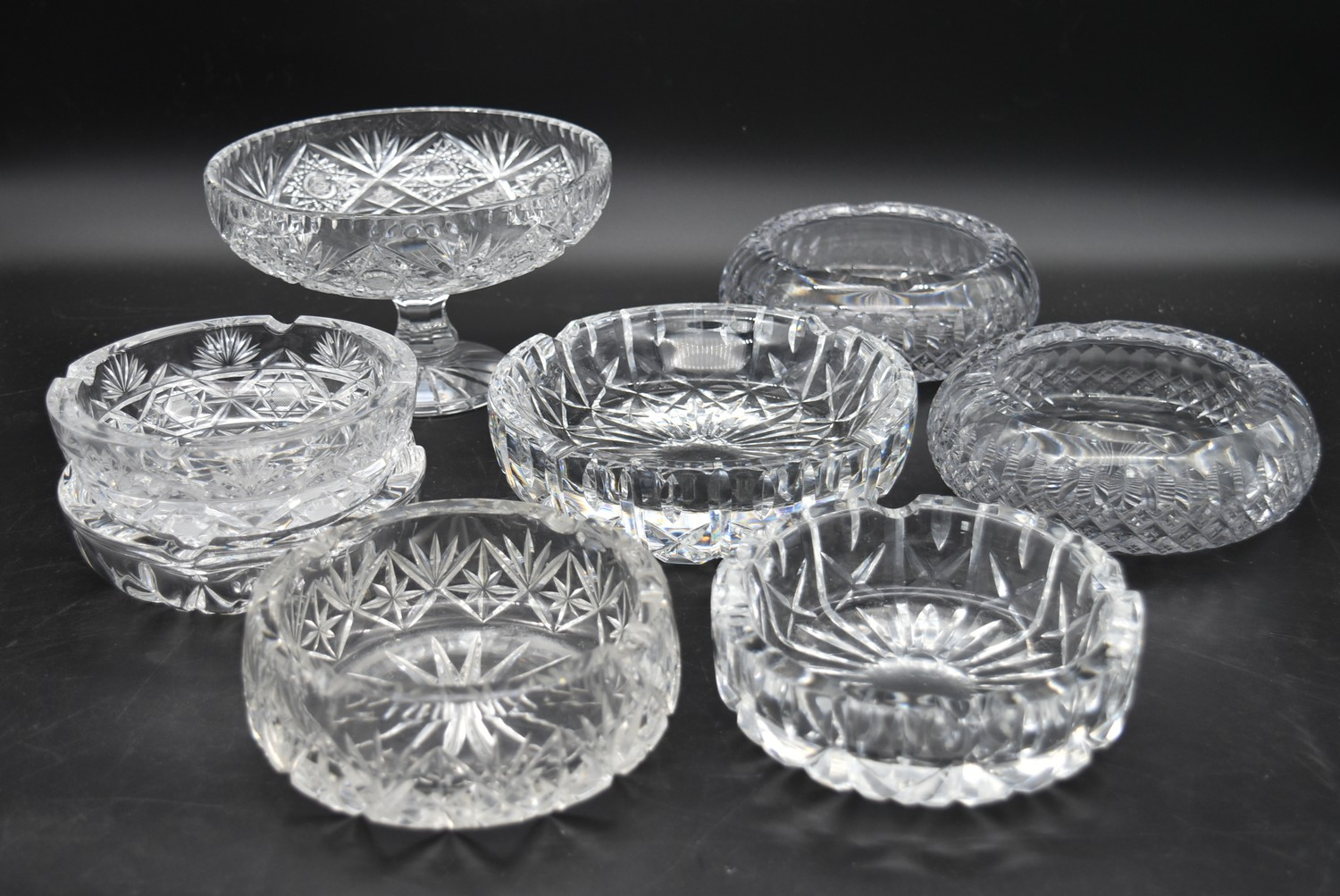 A miscellaneous collection of eight large cut crystal dishes and ashtrays. H.13cm W.21cm