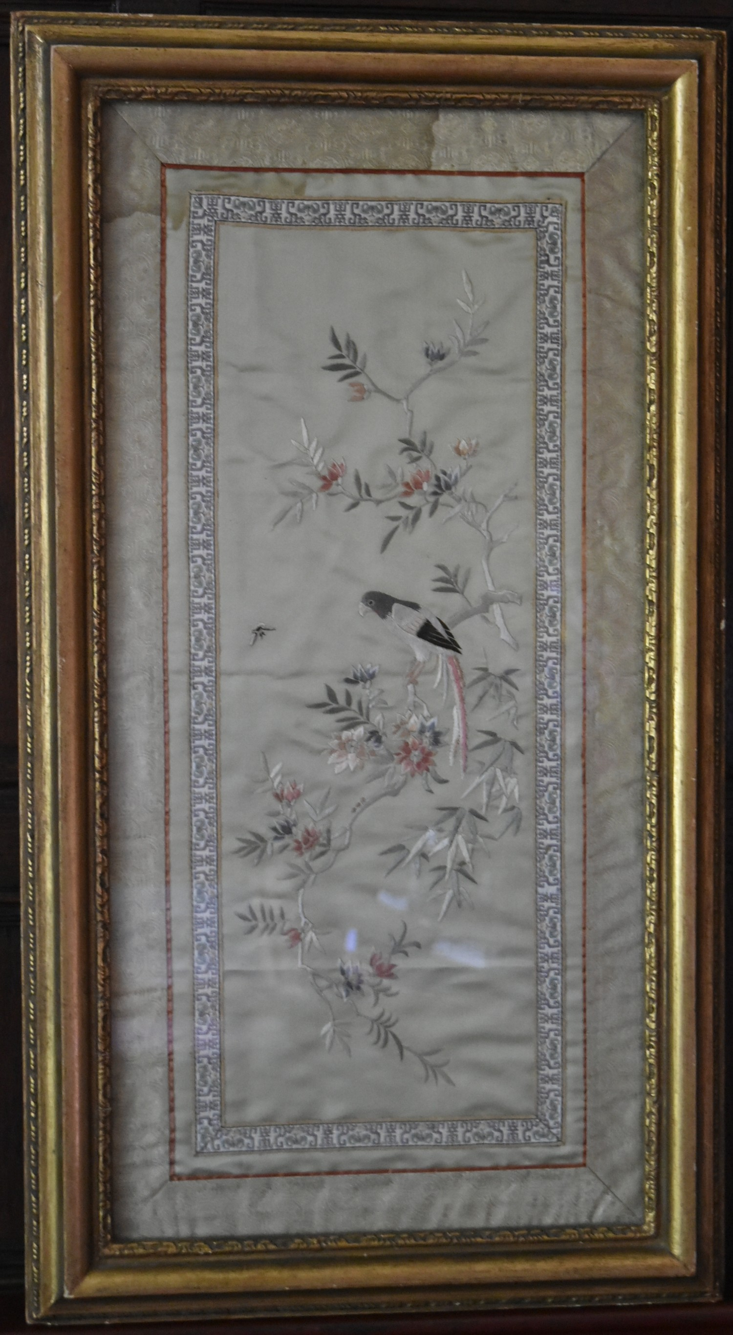 A Japanese framed and glazed silk work embroidery of a parakeet on a branch with blossom contained - Image 2 of 3