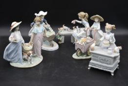 A collection of five Lladro figure groups of children in various activities. H.24cm W.24cm