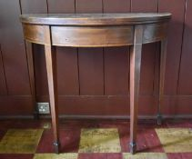 A Georgian mahogany and satinwood crossbanded demi lune tea table with fold over top on square