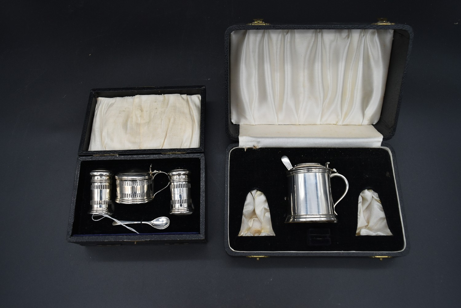 A cased silver cruet, mustard pot and spoon and salt and pepper shakers, CBrs for Clifford Brothers,