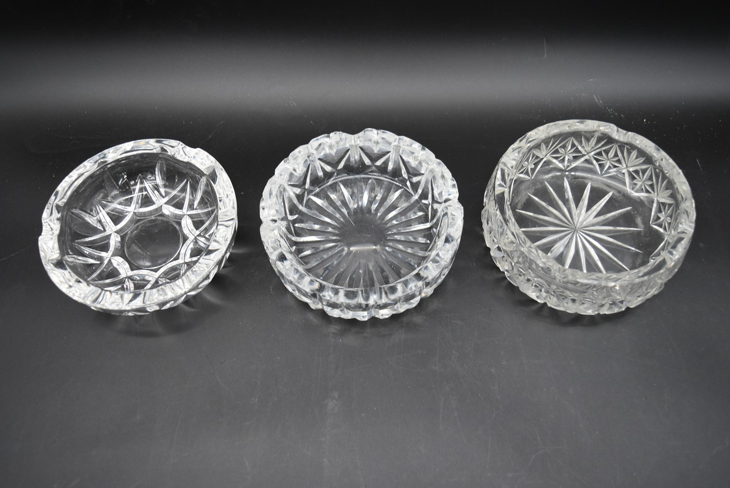 A miscellaneous collection of eight large cut crystal dishes and ashtrays. H.13cm W.21cm - Image 8 of 11