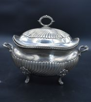 A 19th century Italian silver twin handled tureen and cover with half gadrooned shaped body and