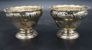 A pair of silver bowls with repousse Rococo decoration, hallmarked HA for Atkin Brothers, Sheffield,
