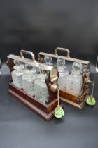 A 19th century silver plated and mahogany cased three bottle locking tantalus and a similar faux