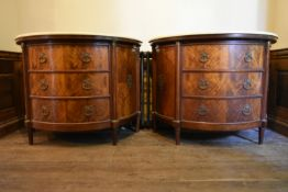 A pair of early 20th century French Empire style figured mahogany demi lune side cabinets with