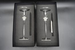 A pair of boxed Versace glass candlesticks with the Medusa mask motif to the stems by Rosenthal. H.