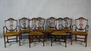 A set of eight mahogany Hepplewhite style dining chairs with pierced wheatsheaf backs above drop