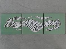 A triptych of three oils on canvas depicting an abstract zebra stripe design, signed Naluyele, 2005.