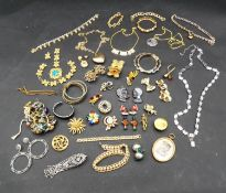 A large collection of vintage and costume jewellery. Including brooches, bracelets, necklaces, rings