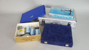A collection of various coin collectors tools and storage cases. Including capsules, wallets,