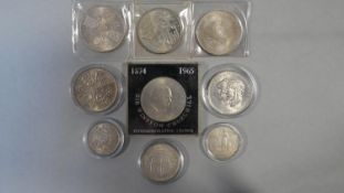 Nine silver coins in cases. Including a 1965 Sir Winston Churchill commemorative silver proof crown,