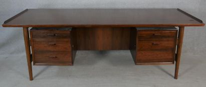 Arne Vodder, a Danish executives desk, model 207 for Sibast with lipped floating top above drawers