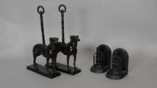 A pair of cast iron doorstops in the form of hunting dogs and a pair of metal birdcage bookends. H.