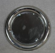 A vintage chrome framed porthole style mirror with inset bevelled plate. D.68cm