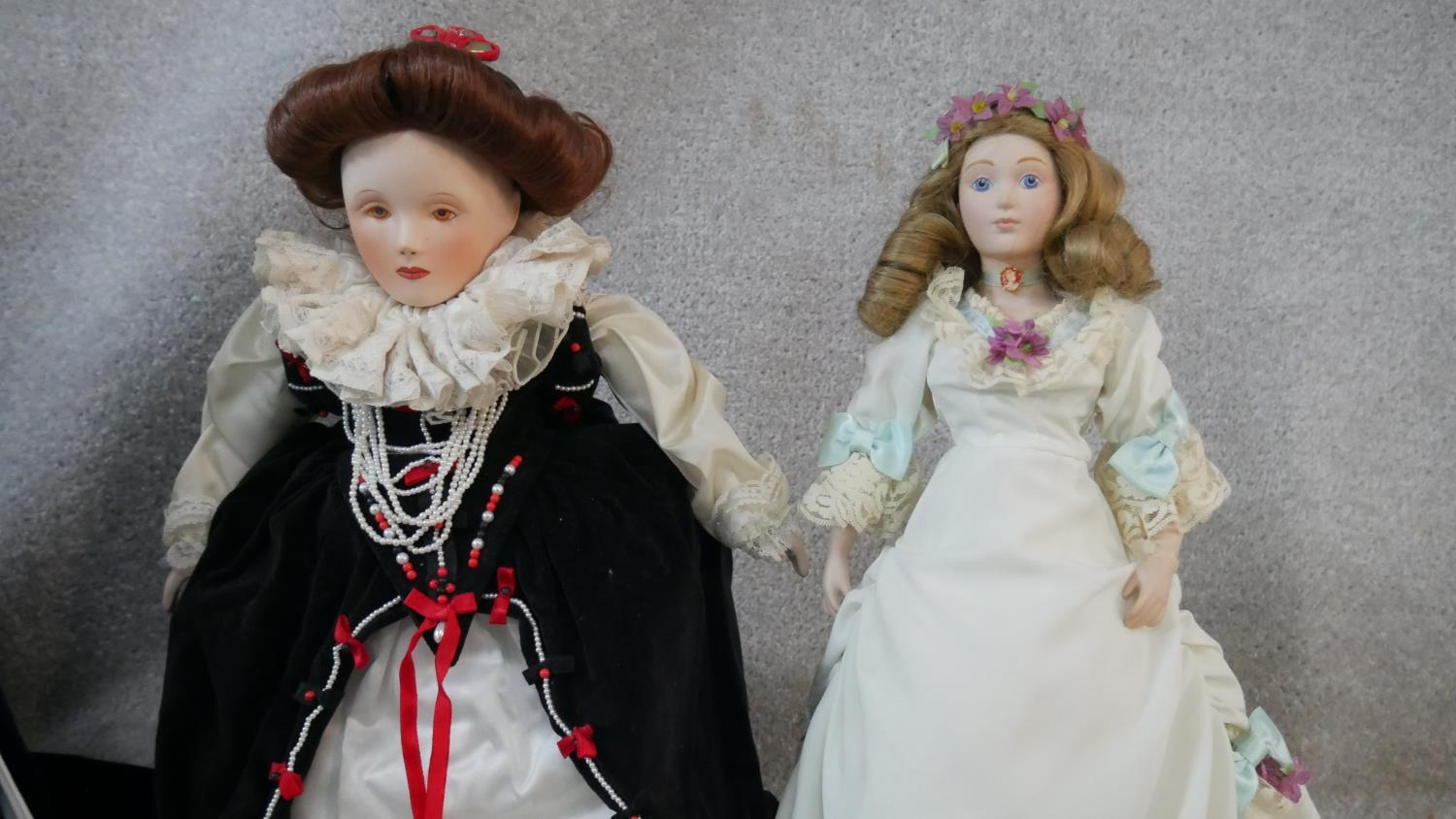 A collection of fourteen porcelain headed Franklin Heirloom Dolls, boxed and with paperwork. H. - Image 3 of 13