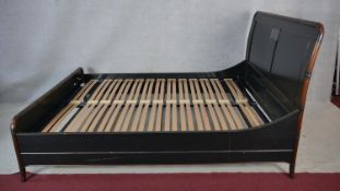 A Chinese style lacquered bedstead in faux bamboo frame to take a 5 ft mattress.