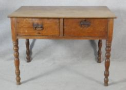 A 19th century mahogany writing table fitted with two deep frieze drawers on tapering ring turned
