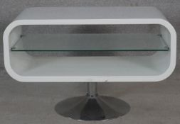 A contemporary occasional table or T.V. stand on metal tulip base. H.50.5 W.80 D.40cm
