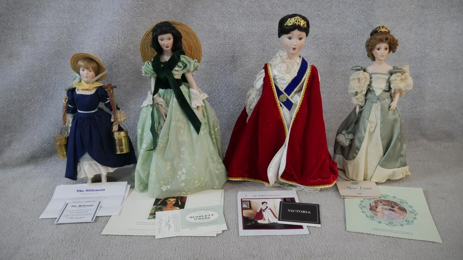 A collection of fourteen porcelain headed Franklin Heirloom Dolls, boxed and with paperwork. H. - Image 10 of 13