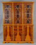 A Georgian style triple section library bookcase with astragal glazed doors enclosing book shelves