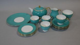 A part six person Wedgwood tea service. The set has a dappled turquoise and gilt design. Makers