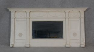 A 19th century Adam style overmantel mirror with dentil cornice with swag decoration above central
