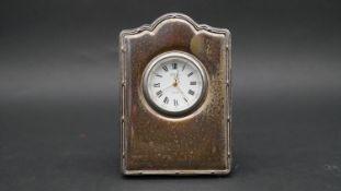 A velvet backed silver fronted easel desk clock by Richard Carr. White enamel dial, gilded