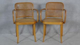 A pair of vintage Dinette bentwood armchairs with maker's plaque to the underside. H.81cm