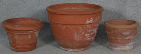 A collection of three various terracotta garden pots. H.26 D.35cm (Largest)