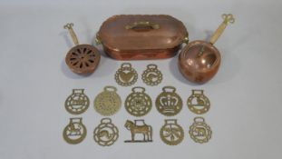 An antique hammered copper and brass lidded warming pot on stand and a pair of similar woven