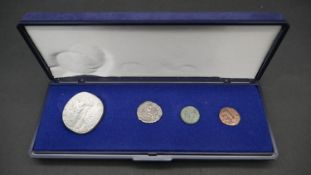 Four ancient Roman coins. Including an ancient roman silver coin depicting Securitas seated on a