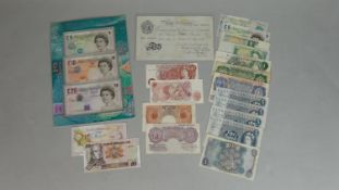 A collection of various world and British notes. Including a Bank of England Beale white five-