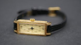 A vintage 18ct yellow gold ladies cocktail watch by Sarcar, Genève. Case has a bark texture. With