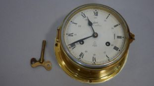 A Schatz Royal Mariner brass cased ship's clock, two train eight day movement with key. D.17cm