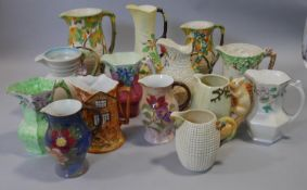 A collection of hand painted Carlton Ware, Royal Doulton, Wade and other vintage ceramic jugs.